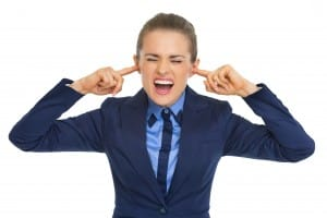 Business woman closing ears