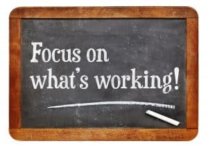 board, written on it, focus on what's working, How to Manifest When Things Fall Apart